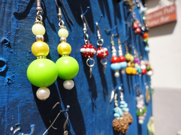 Earrings hanging outside of a shop in Sorrento